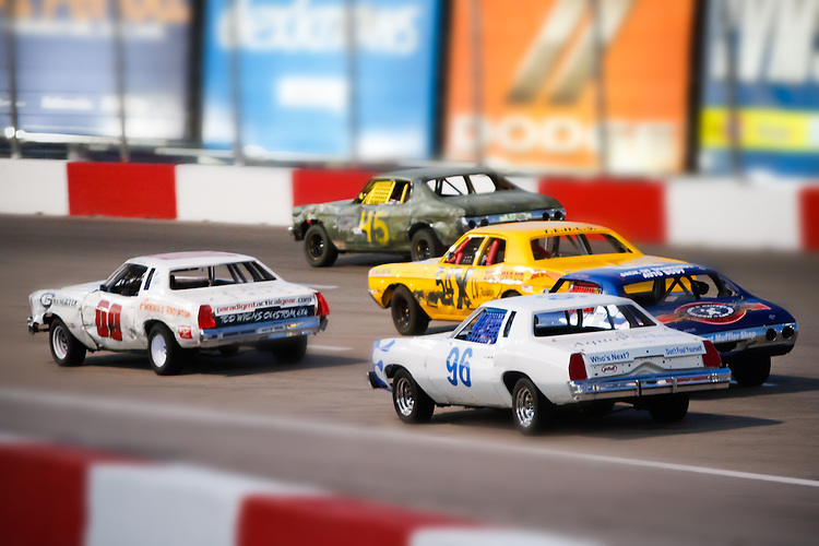 May 14, 2011: Bomber cars appear as miniatures while racing down the backstretch at The Bullring at Las Vegas Motor Speedway. (Note to editors: Photoshop Manipulation/Edit)