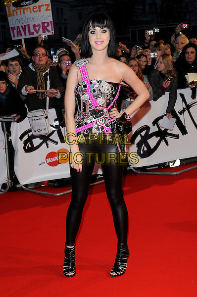 KATY PERRY .Arrivals - 2009 Brit Awards, Earls Court, London, England, February 18th 2009..brits full length black and pink Hello Kitty embellished bustier corset top leggings wet look shiny diamante Dolce Vita strappy shoes booties open toe hand on hip .CAP/FIN.©Steve Finn/Capital Pictures