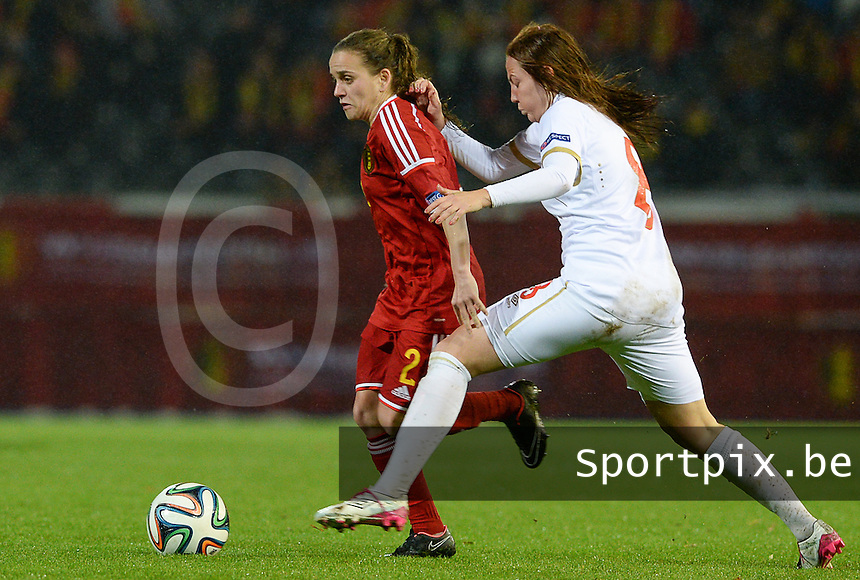 20151130 - LEUVEN ,  BELGIUM : Belgian Davina Philtjens (left) pictured in a duel with Marija Ilic (r) during the female soccer game between the Belgian Red Flames and Serbia , the third game in the qualification for the European Championship in The Netherlands 2017  , Monday 30 November 2015 at Stadion Den Dreef  in Leuven , Belgium. PHOTO DAVID CATRY