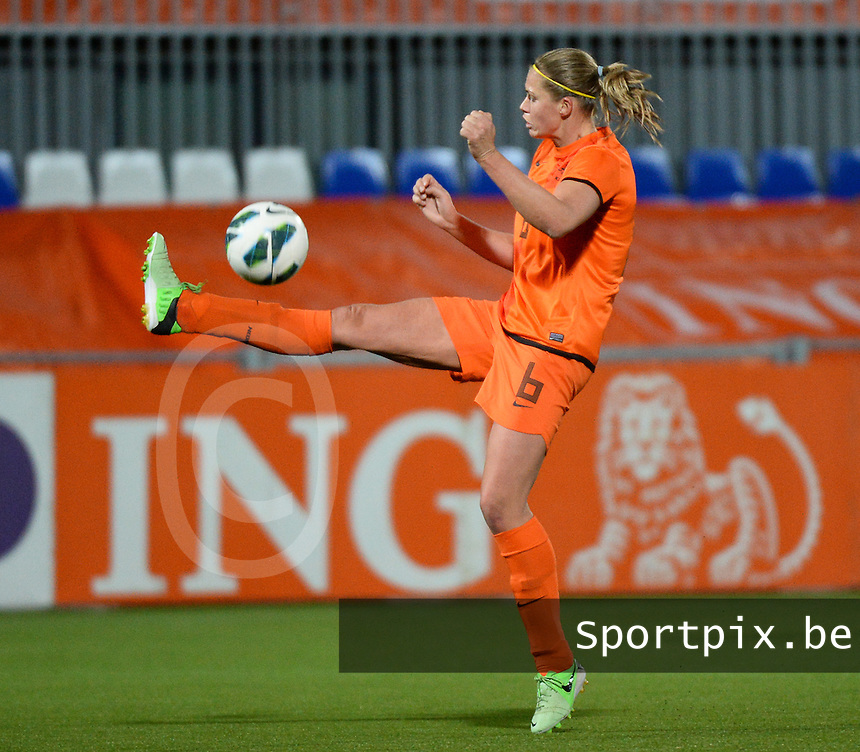 20140212 - ZWOLLE , THE NETHERLANDS : Dutch Anouk Dekker pictured during the female soccer match between The Netherlands and Belgium , on the fifth matchday in group 5 of the UEFA qualifying round to the FIFA Women World Cup in Canada 2015 at Het Ijseldelta Stadion , Zwolle . Wednesday 12th February 2014 . PHOTO DAVID CATRY
