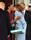 First Lady Michelle Obama kisses Melania Trump as the President and President-elect look on at the White House before the inauguration on January 20, 2017 in Washington, D.C.  Trump becomes the 45th President of the United States.      <br /> Credit: Kevin Dietsch / Pool via CNP