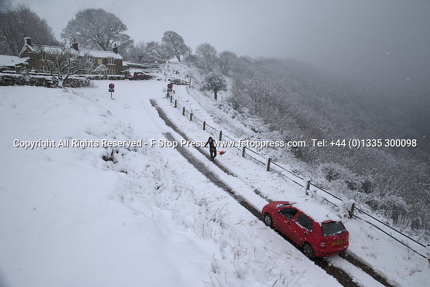 """21/01/15<br /> <br /> With a backdrop to one of the best views in the Derbyshire Peak District, Hilary Stephens single-handedly spends two hours digging 500 yards of tracks and spreading grit on them to help her car make it up the hill at Monsal Head. She needed to clear the one-in-five hill so she could get out to feed her horse. She said: """"I chose a bad day to have my four-by-four serviced! But you've got to carry on if you have animals""""<br /> <br /> All Rights Reserved - F Stop Press.  www.fstoppress.com. Tel: +44 (0)1335 300098"""