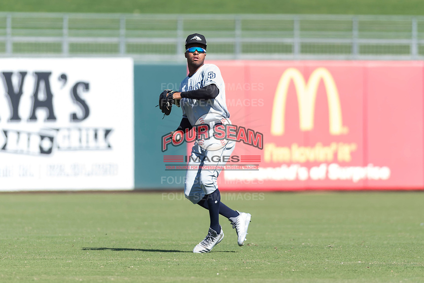 Peoria Javelinas left fielder Buddy Reed (85), of the San Diego Padres organization, prepares to make a throw to the infield during an Arizona Fall League game against the Surprise Saguaros at Surprise Stadium on October 17, 2018 in Surprise, Arizona. (Zachary Lucy/Four Seam Images)