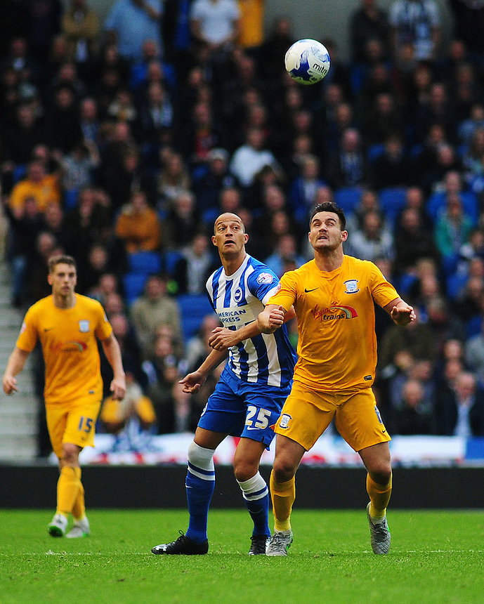 Preston North End's Bailey Wright wins this header against Brighton &amp; Hove Albion's Bobby Zamora<br /> <br /> Photographer kevin Barnes/CameraSport<br /> <br /> Football - The Football League Sky Bet Championship - Brighton and Hove Albion v Preston North End - Saturday 24th October 2015 - American Express Community Stadium - Brighton <br /> <br /> &copy; CameraSport - 43 Linden Ave. Countesthorpe. Leicester. England. LE8 5PG - Tel: +44 (0) 116 277 4147 - admin@camerasport.com - www.camerasport.com