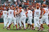 The Texas Longhorn baseball team mobs Jordan Etier #7 after his walk-off RBI against the Texas A&M Aggies on April 29, 2012 at UFCU Disch-Falk Field in Austin, Texas. The Longhorns beat the Aggies 2-1 in the last ever regular season game scheduled for the long time rivals. (Andrew Woolley / Four Seam Images)
