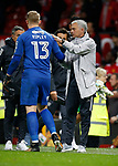 Jose Mourinho manager of Manchester United consoles Connor Ripley of Burton Albion during the Carabao Cup Third Round match at the Old Trafford Stadium, Manchester. Picture date 20th September 2017. Picture credit should read: Simon Bellis/Sportimage