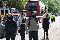 Protest at Lunar house in Croydon by the facsist English Volunteer Force agianst Islam and immigration. Counter protest by Unite Against Fascism the PCS and South London Anti Fascists. 27-7-13 There were scuffles with police as the two sides neared each other.