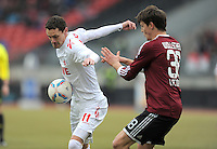 FUSSBALL   1. BUNDESLIGA  SAISON 2011/2012   22. Spieltag 1 FC Nuernberg - 1. FC Koeln       18.02.2012 Milivoje Novakovic (li, 1. FC Koeln) gegen Philipp Wollscheid (1 FC Nuernberg)
