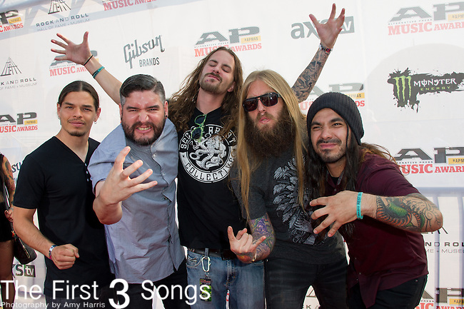 Chris Garza, Mark Heylmun, Alex Lopez, Dan Kenny, and Hernan Hermida of Suicide Silence attend the 2014 AP Music Awards at the Rock And Roll Hall Of Fame and Museum at North Coast Harbor in Cleveland, Ohio.