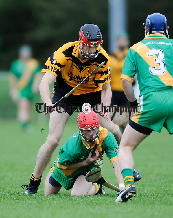 O Callaghan's Mill's James Shanahan is tackled by Darach Honan of Clonlara during their Senior championship game at Sixmilebridge. Photograph by