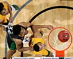 SIOUX FALLS, SD - MARCH 10: Tyson Ward #24 and teammate Cameron Hunter #22 of the North Dakota State Bison sandwich De'Sean Allen-Eikens #34 of the North Dakota Fighting Hawks on a rebound during the men's championship game at the 2020 Summit League Basketball Tournament in Sioux Falls, SD. (Photo by Dave Eggen/Inertia)