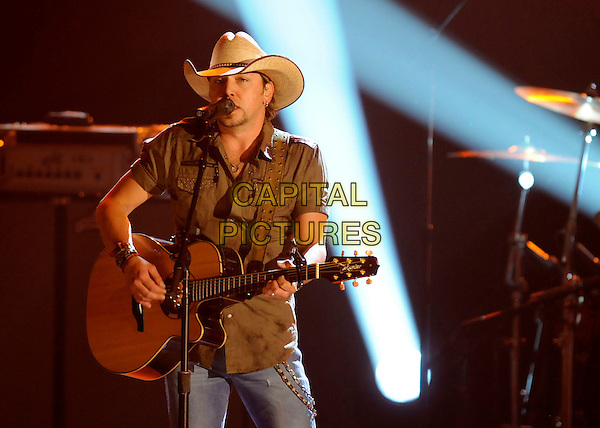 JASON ALDEAN .performs during the 43rd Annual CMA Awards, Country Music's Biggest Night, held at the Sommet Center, Nashville, Tennessee, USA, 11th November 2009. live show on stage half length concert gig music guitar microphone singing playing cowboy hat green khaki shirt  .CAP/ADM/LF.©Laura Farr/AdMedia/Capital Pictures.