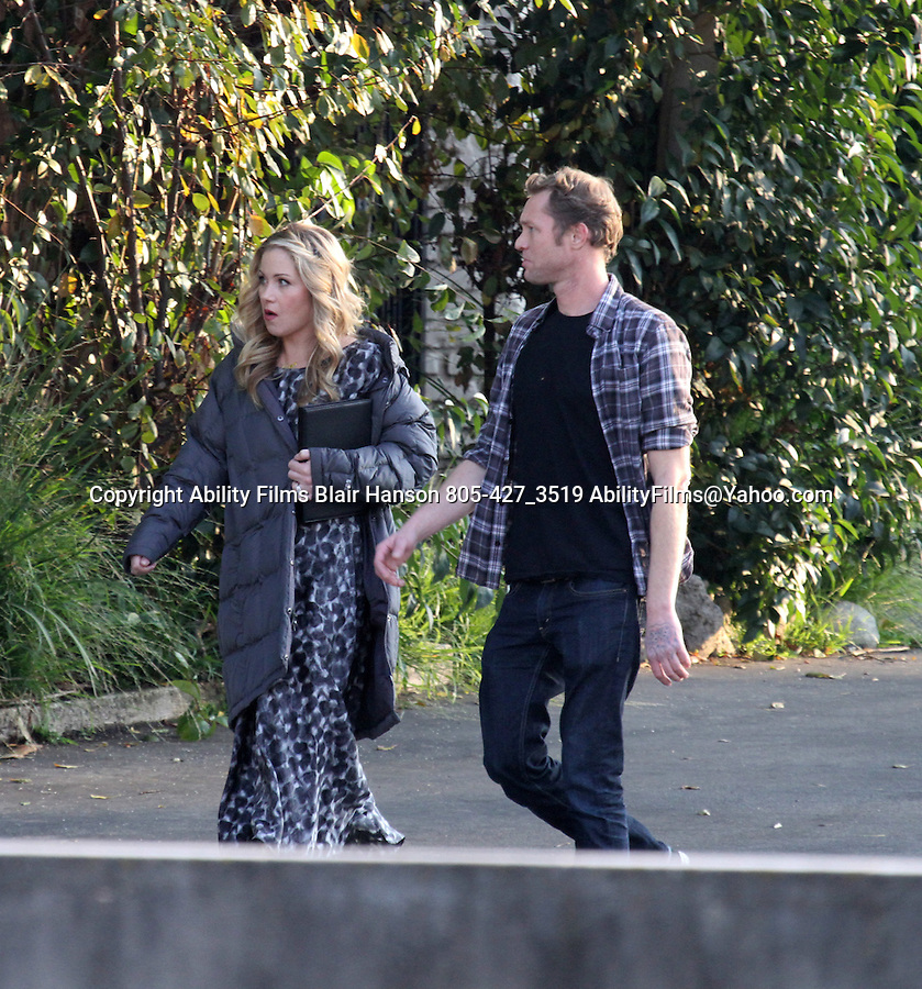 December 14th 2011 ...Christina Applegate filming a wedding scene for her new tv show Up All Night in Los Angeles wearing a wedding ring holding a laptop or book wearing a big jacket walking with  a man with no front tooth ..AbilityFilms@yahoo.com.805-427-3519.www.AbilityFilms.com...