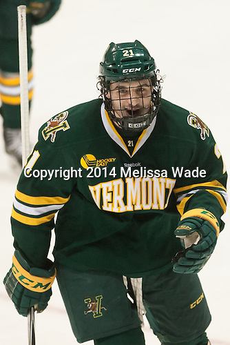 Mario Puskarich (UVM - 21) - The visiting University of Vermont Catamounts defeated the Northeastern University Huskies 6-2 on Saturday, October 11, 2014, at Matthews Arena in Boston, Massachusetts.