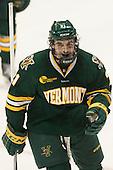 Mario Puskarich (UVM - 21) - The visiting University of Vermont Catamounts defeated the Northeastern University Huskies 6-2 on Saturday, October 11, 2014, at Matthews Arena in Boston, Massachusetts.