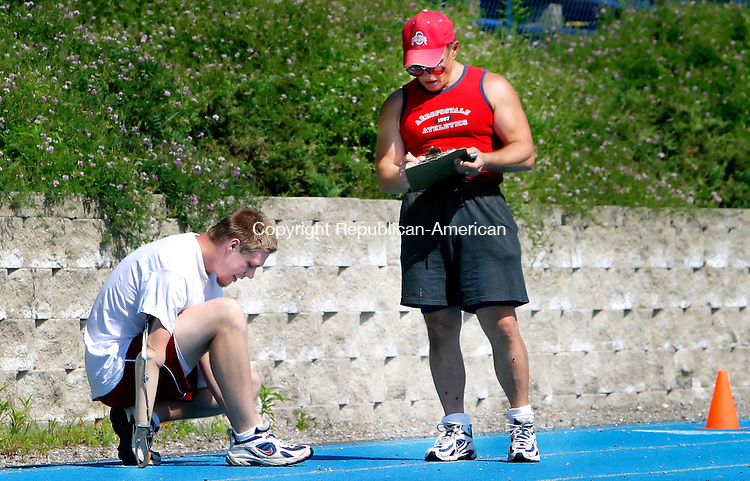 SEYMOUR, CT. 17 July 2006--071706SV06--Donald Kosakowski Jr. of Oxford trains with his dad Donald Kosakowski Sr. at the Seymour High School Track in Seymour Monday. Kosakowski made the 2006 U.S. Paralymic Track and Field Team. He competes for the Southern Connecticut State University men's team.<br /> Steven Valenti Republican-American
