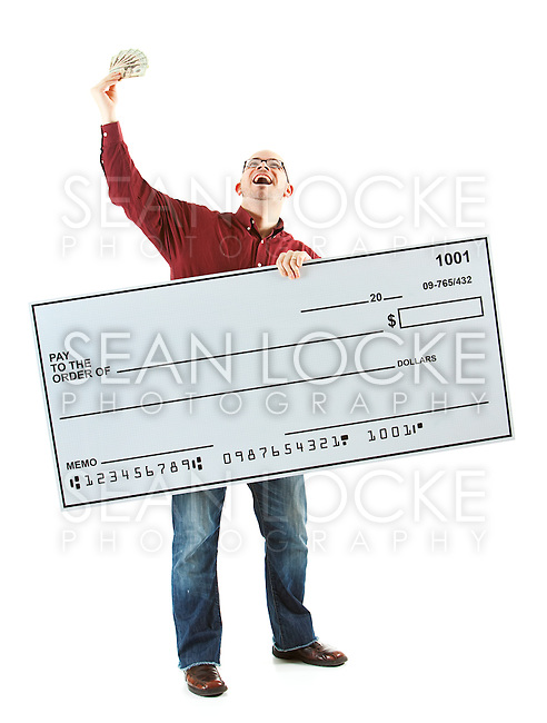 Isolated on white background series of a Caucasian man with an oversized bank check.