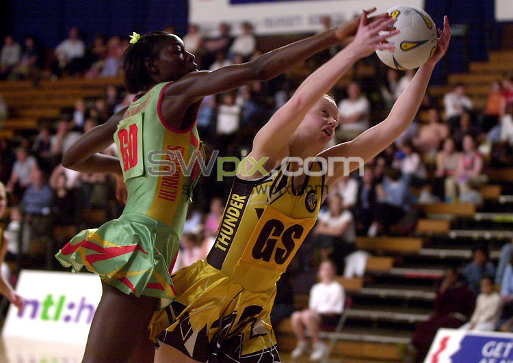 Pix: Matthew Lewis/SWpix.com. Netball. Super Cup 2003. Aston Villa Sports Centre. 17/05/2003...COPYRIGHT PICTURE>>SIMON WILKINSON>>01943 436649>>..London Hurricanes Sonia Mkoloma and Northern Thunder's Lesley MacDonald challenge for the ball.
