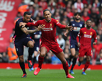 7th March 2020; Anfield, Liverpool, Merseyside, England; English Premier League Football, Liverpool versus AFC Bournemouth; Virgil van Dijk of Liverpool fends off a challenge from Callum Wilson of Bournemouth