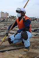 A search and rescue ...worker in.... the remains of a houses in the town of Natori, after the Tsunami devastated the entire pacifc coastline of Japan after the earthquake and tsunami devastated the area Sendai, Japan.One of the biggest earthquakes ever recorded struck off the coast of Japan on 11 Mar 2011 had killed thousands of people. The death toll was expected to rise dramatically, with tens of thousands reported missing..14 Mar 2011.