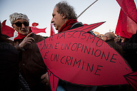 """Rome, 14/12/2019. Today, tens of thousands of people gathered in Rome's Piazza San Giovanni holding the first demo in the Italian Capital of the growing """"Sardines"""" movement. The Sardines (1.) was founded in November in Bologna to protest against the leader of the far-right party Lega/League Matteo Salvini (2.) launching the campaign for the Emilia-Romagna regional election. Lucia Bergonzoni, Lega/League former deputy Minister of Culture, will compete in the elections against the Democratic Party PD president, Stefano Bonaccini. One of the four founders of the Sardines, Mattia Sartori, 32, told AFP: """"We are anti-fascist, pro-equality, against intolerance, against homophobia"""", as protesters sang the anti-fascist anthem Bella Ciao. From the Facebook event page (3.): «The wave of civilization, pacifism and humanity that is going through all of Italy could only reach Rome. A city based on culture, art, solidarity and sense of community. All this is endangered by those who want to describe us as a frightened people, by those who build consensus by exploiting an aggressive and provocative rhetoric, by those who think politics is a drama, by those who are convinced that everything can be exploited for a few more votes. The good news is that there is an alternative. But we must take action, take back the squares and reiterate that no political confrontation will be possible if certain democratic conditions are not guaranteed. The modes are simple but powerful. Create a sardine, take it to the square, send a message without the need for flags or symbols. Rediscover yourself part of a colorful, non-violent but fierce community […]».<br /> <br /> Footnotes & Links:<br /> 1. https://www.facebook.com/6000sardine<br /> 2. Salvini san giovanni<br /> 3. http://bit.do/fkTHi<br /> Video (Source, Repubblica.it) http://bit.do/fkTUy<br /> Article (Source, TheGuardian.com) http://bit.do/fkTGF"""