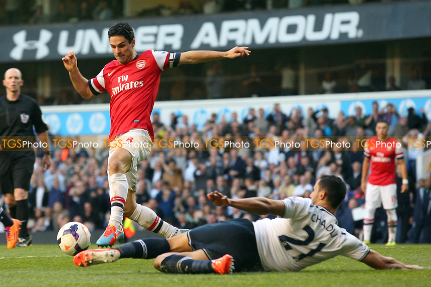 Mikel Arteta of Arsenal avoids the tackle of Nacer Chadli of Tottenham Hotspur - Tottenham Hotspur vs Arsenal, Barclays Premier League Football at the White Hart Lane Stadium - 16/03/14 - MANDATORY CREDIT: Dave Simpson/TGSPHOTO - Self billing applies where appropriate - 0845 094 6026 - contact@tgsphoto.co.uk - NO UNPAID USE