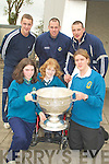 HOL;DING: Aisling Kelly, Ciara O'Mahony and Richard Raftery of Mounthawk Mercy Secondry School got their wish on Thursday as to hold the Sam Magiuire Cup looking on were Aidan O' Shea (Teacher), Michael Quirke and Kieran Donaghy (members of the victorious Kerry Team)...