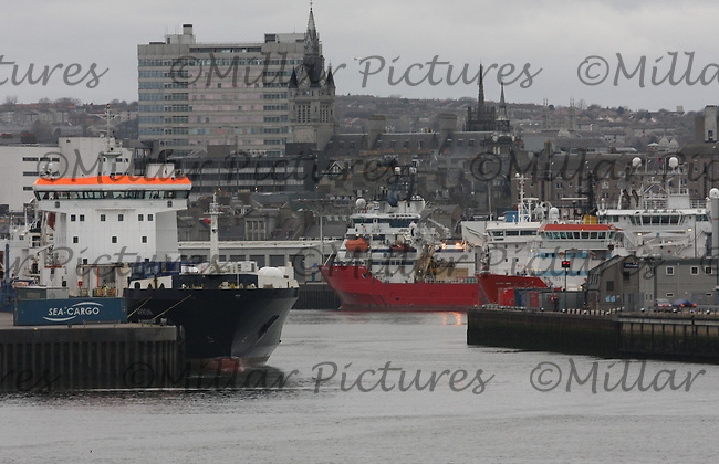 General view of Aberdeen harbour with various types of ships docked.