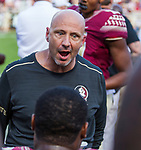 Florida State defensive coordinator Charles Kelly talks to his players in the 2nd half of an NCAA college football game against Louisiana Monroe in Tallahassee, Fla., Saturday, Dec. 2, 2017. Florida State defeated Louisiana Monroe 42-10.  (AP Photo/Mark Wallheiser)