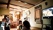 Garden City, Kansas, USA, August 2011:.Maria, immigrant from Mexico with family at her trailer home. Many hispanic immigrants from Mexico and Salvador live in the trailers. Most of them came here to work at Tyson meatpacking plant, which kills and processes 6 thousand cattle a day. Kansas dominates American beef industry, by producing one quarter of all beef in the USA, while being heavily dependent on cheap immigrant labour..(Photo by Piotr Malecki / Napo Images)..Garden City, Kansas, Stany Zjednoczone, Sierpien 2011:.Maria, emigrantka z Meksyku, z rodzina w swoim domu - przyczepie. Duzo emigrantow z Meksyku i Salwadoru mieszka w przyczepach samochodowych, a pracuje w zakladach miesnych Tyson, ktore zabijaja i przerabiaja 6 tysiecy sztuk bydla dziennie. Stan Kansas zdominowal rynek wolowiny w Stanach Zjednoczonych, produkujac jedna czwarta calej amerykanskiej wolowiny. Amerykanski przemysl miesny jest bardzo uzalezniony od taniej sily roboczej, ktora daja emigranci..Fot: Piotr Malecki / Napo Images.