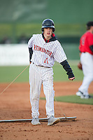 Kannapolis Intimidators bat boy Allan Westerholt drags the infield between innings of the South Atlantic League game against the Hickory Crawdads at Kannapolis Intimidators Stadium on April 10, 2016 in Kannapolis, North Carolina.  The Intimidators defeated the Crawdads 10-3.  (Brian Westerholt/Four Seam Images)
