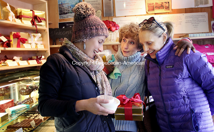 GOSHEN CT. 24 November 2015-112415SV11-From left, Val Khislavsky of Canton, Alla Yanovsky Tilton of Canton, and Pamula McCann of Litchfield shop for holiday chocolate at Thorncrest Farm in Goshen Tuesday. <br /> Steven Valenti Republican-American