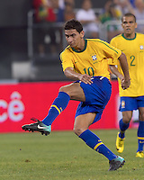 Brazil midfielder Paulo Henrique Ganso (10) follows through on a shot. Brazil  defeated the US men's national team, 2-0, in a friendly at Meadowlands Stadium on August 10, 2010.
