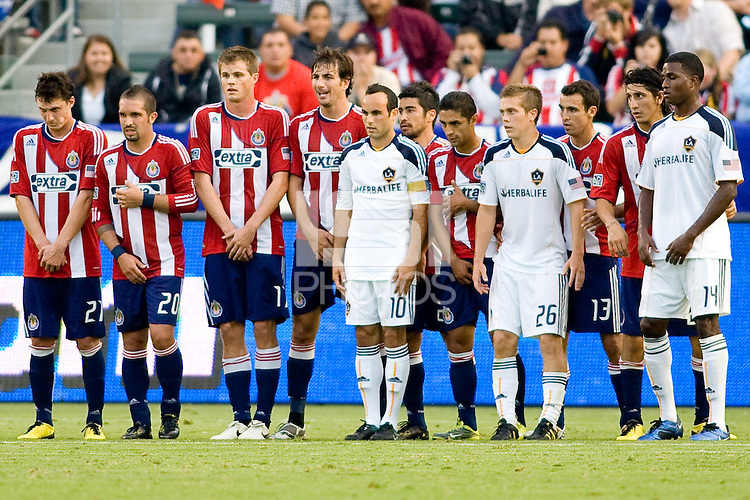 A wall consisting of players from both teams the LA Galaxy and CD Chivas USA from left to right Ben Zemanski, Giancarlo Maldonado, Justin Braun, Alan Gordon, Landon Donovan, Paulo Nagamura, Mariano Trujillo, Michael Stephens, Jonothan Bornstein, Carlos Borja and Edson Buddle. The LA Galaxy beat Chivas USA 2-1 at Home Depot Center stadium in Carson, California on Sunday October 3, 2010.