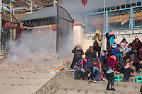 East Village, Diqing Tibetan Autonomous Prefecture, Yunnan Province, China - Tibetan villagers react to firecrackers at the beginning of traditional Xianzi Dance, February 2017.