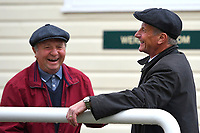 Trainer Rod Millman right shares a joke with course flagman and ex jockey Bob Currant outside the weighing Room during Horse Racing at Salisbury Racecourse on 14th August 2019