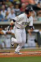 First baseman Dash Winningham (34) of the Columbia Fireflies runs toward first base in a game against the Lexington Legends on Saturday, April 22, 2017, at Spirit Communications Park in Columbia, South Carolina. Lexington won, 4-0. (Tom Priddy/Four Seam Images)