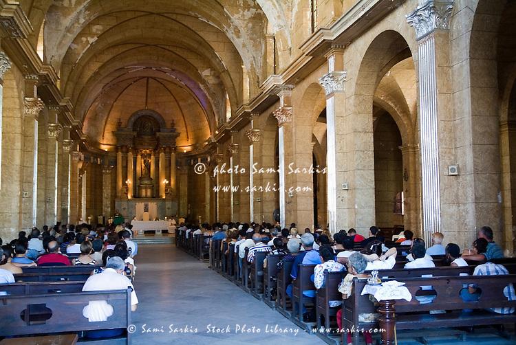 Faithful praying inside Catedral de la Purisima Concepcion, Cienfuegos, Cuba.