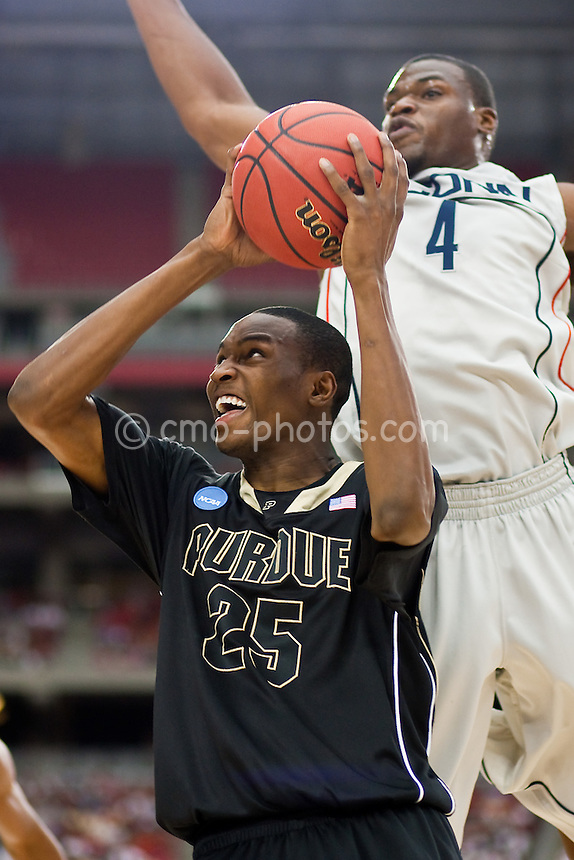 Mar 26, 2009; Tucson, AZ, USA; Connecticut Huskies forward Jeff Adrien (4) tries to block the shot of Purdue Boilermakers forward JaJuan Johnson (25) from behind in the first half of a game in the semifinals of the west region of the 2009 NCAA basketball tournament at University of Phoenix Stadium.    UConn defeated Purdue 72-60.
