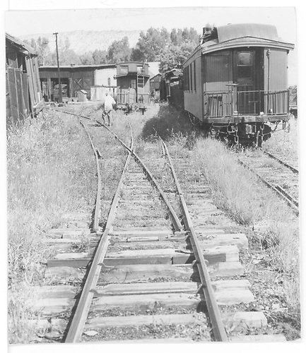 Yards at Ridgway with business car B20 on right, track 7 and caboose on track 5.<br /> RGS  Ridgway, CO  Taken by Maxwell, John W.