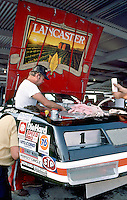 Crewmen work on the #1 Chevrolet Monte Carlo of driver Pancho Carter in preparation for the Southern 500 at Darlington Raceway in Darlington SC on September 1, 1985. (Photo by Brian Cleary/www.bcpix.com)