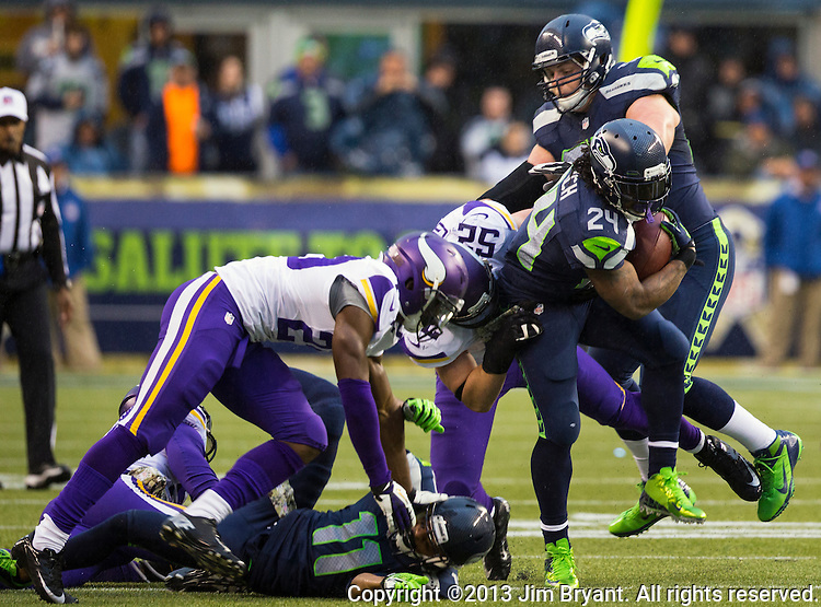Seattle Seahawks running back Marshawn Lynch carries the ball against the  Minnesota Vikings at CenturyLink Field in Seattle, Washington on  November 17, 2013.  Lynch ran for 54 yards and scored two touchdowns in Seahawks 41-20 win over the Vikings.  ©2013.  Jim Bryant. All Rights Reserved.