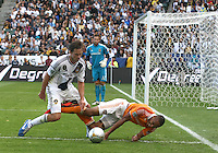 CARSON, CA - DECEMBER 01, 2012:   Todd Dunivant (2) of the Los Angeles Galaxy knocks over Ricardo Clark (13) of the Houston Dynamo during the 2012 MLS Cup at the Home Depot Center, in Carson, California on December 01, 2012. The Galaxy won 3-1.