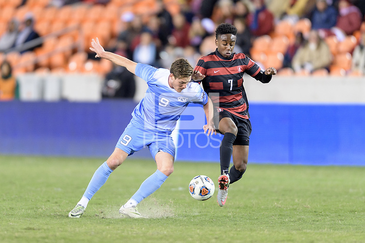 Houston, TX - Friday December 9, 2016: Drew Murphy (9) of the North Carolina Tar Heels and Bryce Marion (7) of the Stanford Cardinal battle for control of the ball at the NCAA Men's Soccer Semifinals at BBVA Compass Stadium in Houston Texas.