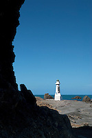 "On New Year's Day 1859 the first lighthouse at Pencarrow Head near Wellington, New Zealand was lit for the first time. In 1906, a second lighthouse, later known as Lower Pencarrow, was erected at the bottom of the Pencarrow cliffs. It was built as a ""day mark"" and to work when fog or low clouds obscured the upper light."