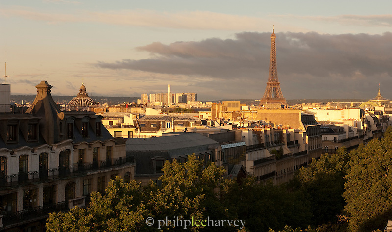 Sunrise view of the Eiffel Tower over the rooftops of Paris, France