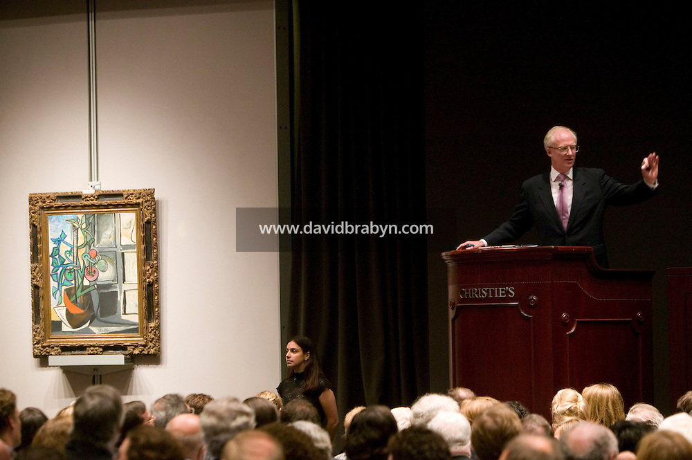 8 November 2006 - New York City, USA - Principal auctioneer Christopher Burge (R) takes bids for Picasso's Plant de tomates (seen left) during an Impressionist and Modern Art Sale at Christie's in New York City, NY, which realized $491,472,000 and nine new world auction records, 8 November 2006. Photo Credit: David Brabyn/Sipa Press<br />