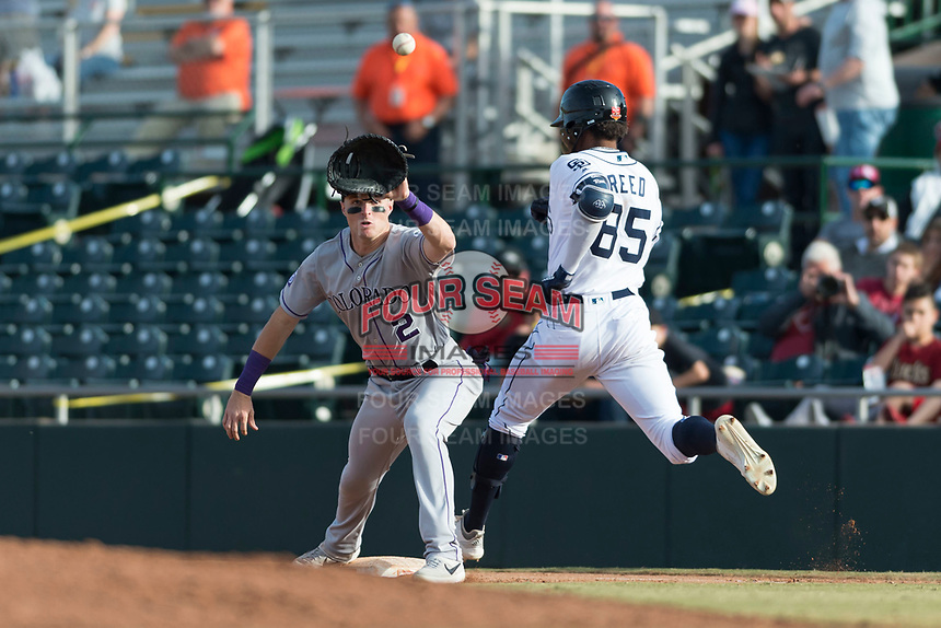 Salt River Rafters first baseman Tyler Nevin (2), of the Colorado Rockies organization, prepares to catch a throw as Buddy Reed (85) runs up the first base line during the Arizona Fall League Championship Game against the Peoria Javelinas at Scottsdale Stadium on November 17, 2018 in Scottsdale, Arizona. Peoria defeated Salt River 3-2 in 10 innings. (Zachary Lucy/Four Seam Images)