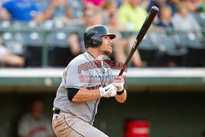 Ryan Doumit #12 of the Indianapolis Indians follows through on his swing against the Charlotte Knights at Knights Stadium on July 26, 2011 in Fort Mill, South Carolina.  The Knights defeated the Indians 5-4.   (Brian Westerholt / Four Seam Images)