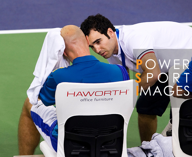 SHANGHAI, CHINA - OCTOBER 13:  Ivan Ljubicic of Croatia receives medical attention during his match against Novak Djokovic of Serbia during day three of the 2010 Shanghai Rolex Masters at the Shanghai Qi Zhong Tennis Center on October 13, 2010 in Shanghai, China.  (Photo by Victor Fraile/The Power of Sport Images) *** Local Caption *** Ivan Ljubicic